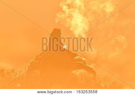 Black grouse breath fume at sunrise in spring