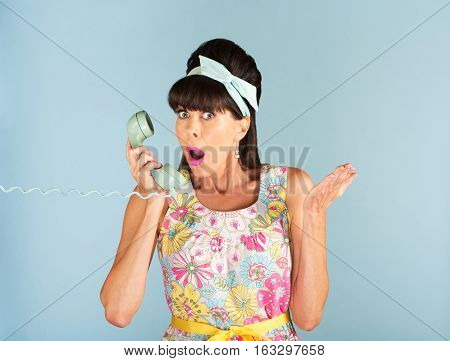 Surprised Woman Holding Land Line Phone