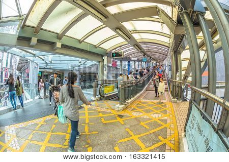 Hong Kong, China - December 4, 2016: fish eye view of crowded Central-Mid-levels escalator on Queen's Road Central, the longest outdoor covered escalator system in the world.