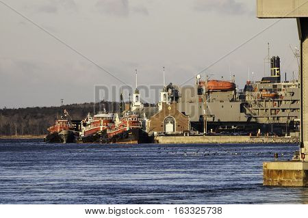 Buzzards Bay Massachusetts USA - March 18 2007: Tugs moored at Massachusetts Maritime Academy in Cape Cod Canal