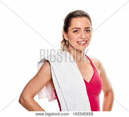 Fitness woman portrait isolated on white background. Smiling happy female fitness model looking at camera
