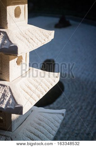 Rock lantern in zen garden stock photo