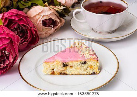 Cheesecake with dried fruits and glaze. Studio Photo