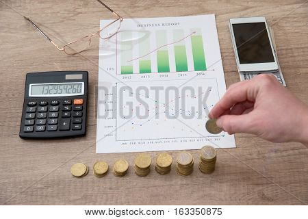 woman hand with calculator and business diagram
