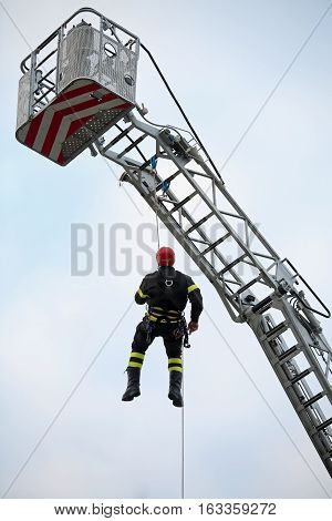 Climber Of Firefighters With Red Helmet Falls From The Ladder Tr
