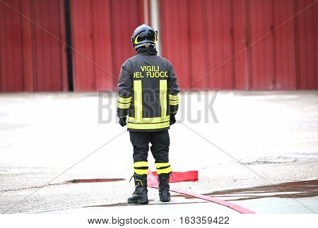 Lonely Italian Firefighters With The Red Fire Hose