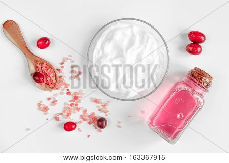 organic cosmetics with extracts of berries on white background top view