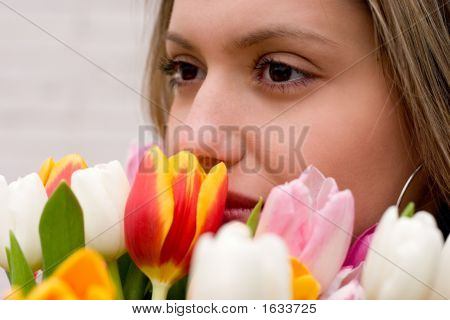 Girl With Bouquet Of Tuilips