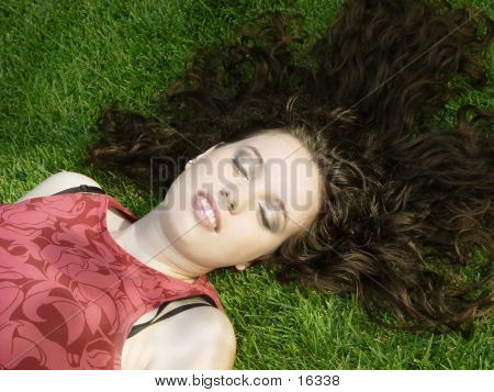 Beautiful Girl Sleeping On The Grass