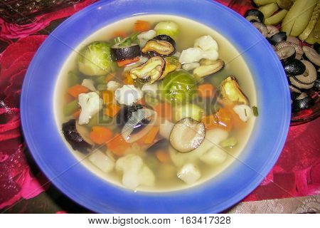 vegetable mussels soup with shellfish in dish