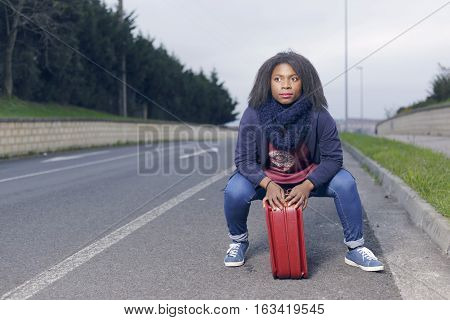 African Girl Hitchhiking On The Road.