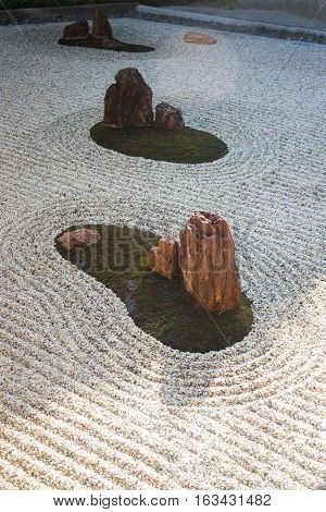 Zen gardens typically contain gravel and bare stones stock photo