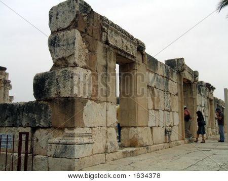 Tourists Going Through An Entrance Of The Great Synagogue Of Capernaum