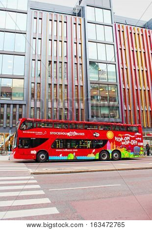 STOCKHOLM, SWEDEN - OCTOBER 17, 2013: Stockholm Bus Touristic. With City Sightseeing Hop On - Hop Off all the best attractions of Stockholm and Djurgarden Island can be observed. Hop on and off works 24 or 72 hours