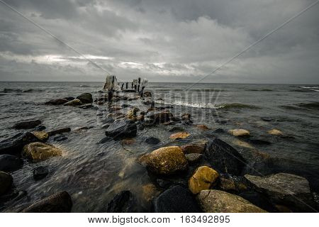 Michigan's Haunted Beach. Pier on the coast of Lake Huron in Forester Michigan is the site of a famous Michigan haunting. Reportedly a female specter, known as Minnie Quay is seen wandering the beach by the old pier pilings.