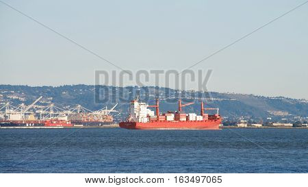 San Francisco CA - December 26 2016: CAP PALMERSTON at anchor in the San Francisco Bay Port of Oakland in the background.