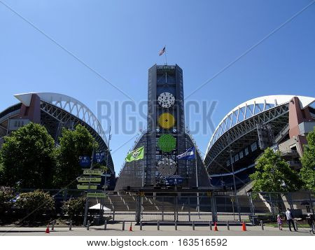 SEATTLE - JUNE 26: USA Flag flies above CenturyLink and Gate fence in Seattle in June 26 2016. Home of the Seattle Seahawks (NFL) and Sounders (MLS).