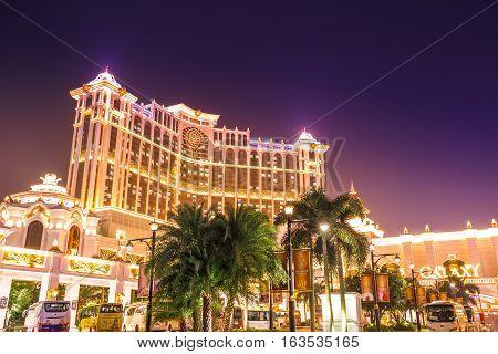 Macau, China - December 8, 2016: night view of colorful Galaxy Macau Resort Hotel Casino in Cotai Strip. Scenic view of Galaxy popular resort complex landmark and lifestyle.