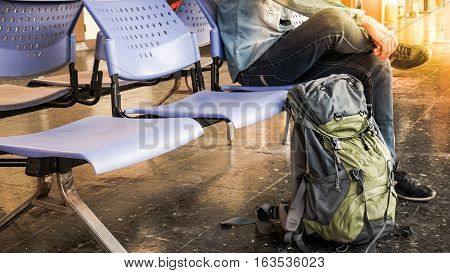 poster of Single Traveler, Backpacker Waiting For Long Journey Travel At Train Station With Backpack. Travel C