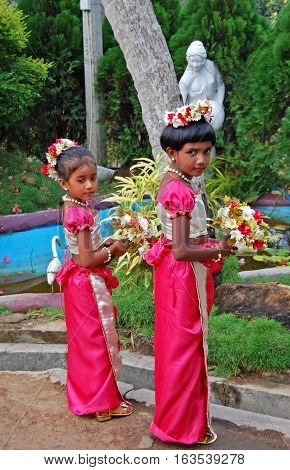 COLOMBO, SRI LANKA - FEBRUARY 19, 2014: Two girls are taking part in wedding ceremony in Sri Lanka. Typically Sri Lankans marry later than people in other Asian countries