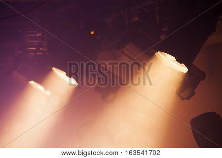Powerful Spot Lights On Smoke Background
