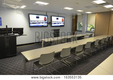 Business student meeting Seminar room conference hall and Seats with Blank TV screens at the university