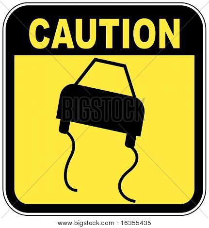 black and  yellow caution sign - road slippery