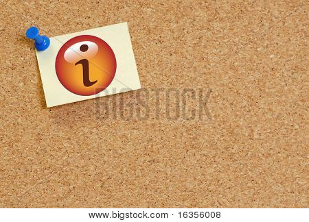 information note pinned on cork board background