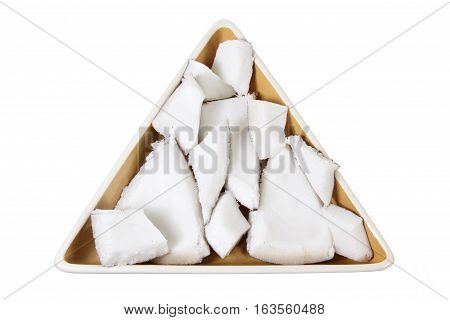 Pieces of Coconut on Triangular Plate on White Background