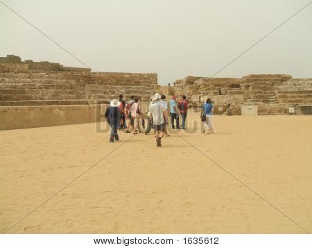 Tourists Leaving The Ancient Roman Theatre In Caesarea