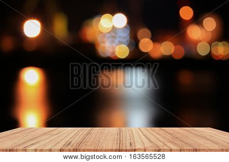 Empty wood table and night light bokeh for Christmas New Year background. with copy space add text