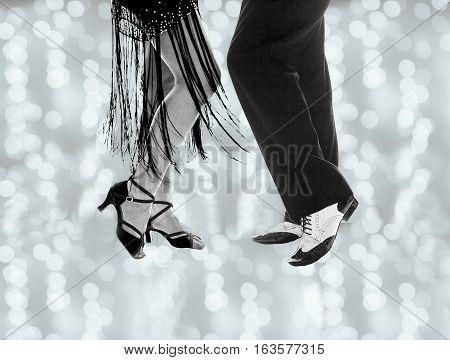 Couple dancing swing and salsa dancing. Defocused background.