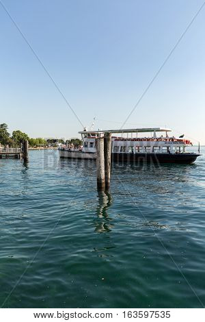 BARDOLINO ITALY - MAY 4 2016: Ferry boat on Lake Garda. Garda Lake is one of the most frequented tourist regions of Italy.