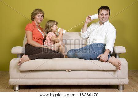 Family playing with mug phone