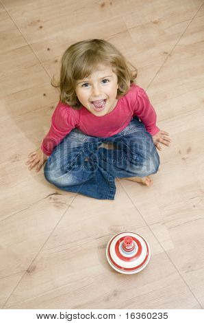 Cute girl playing with spinner