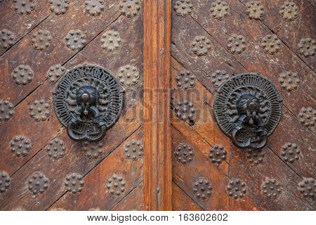 Twin antique handles old style on wooden doors stock photo