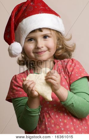 Cute girl making Christmas cookies