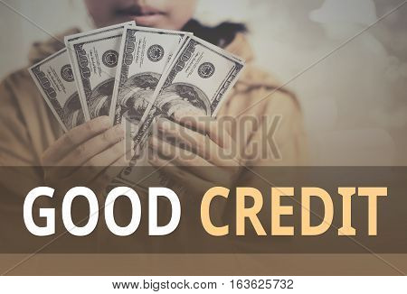 Good Credit Word Over Young Girl Holding Dollar Bills.