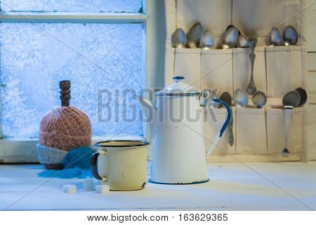 Hot Coffee Pot And Cup With Spoons In Winter