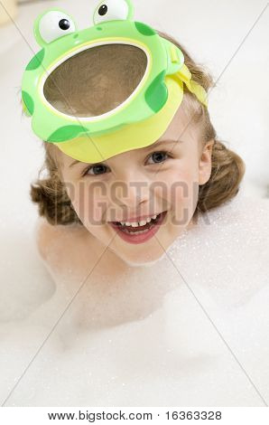 Little girl playing in foam