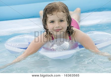 Happy girl playing in water