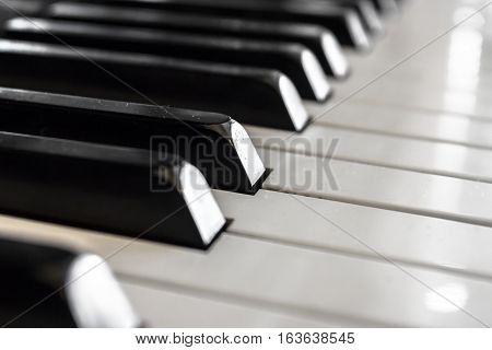 Extreme closeup of a classic vintage piano keyboard. Shallow depth of field. Defocused blurry background.