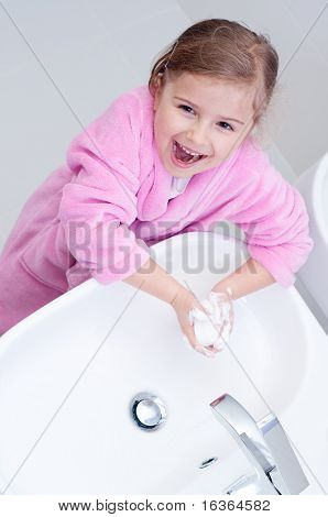 Cute girl washing hands