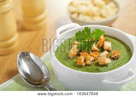 Cream soup with dried crusts on a table