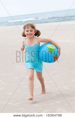 Little girl playing at the beach