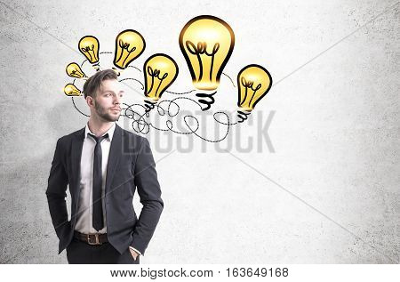 Portrait of a young bearded businessman in a suit standing with his hands in the pockets near a concrete wall with tethered light bulbs sketch. Mock up