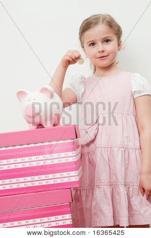 Little girl and piggy-bank