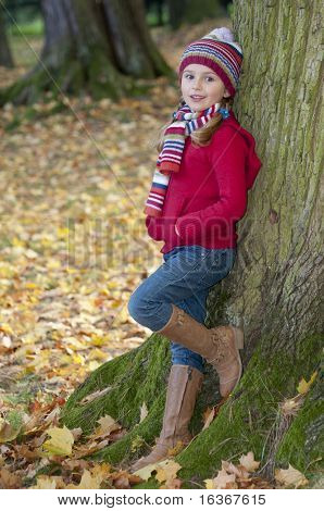 Little fashion girl in autumn park