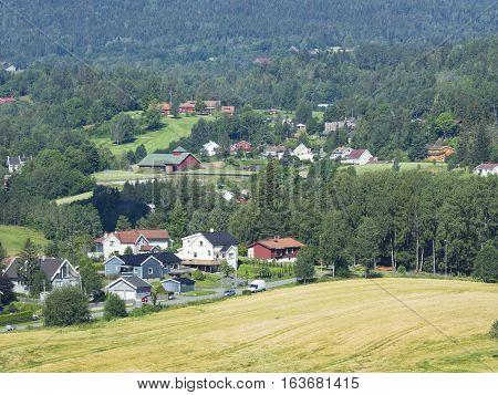 Lommedalen a rural suburbian area half an hours drive outside Oslo the capital of Norway. In the photo are residential areas farms and a golf course in the background.