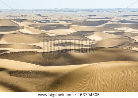 Aerial view with sand dunes on Maranjab Desert in Iran